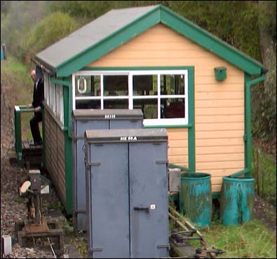 Small cabin built over a ground frame at the south end of Kingscote station