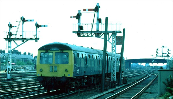 DMU with a train to to Ely just to the north of Cambrige station in BR days
