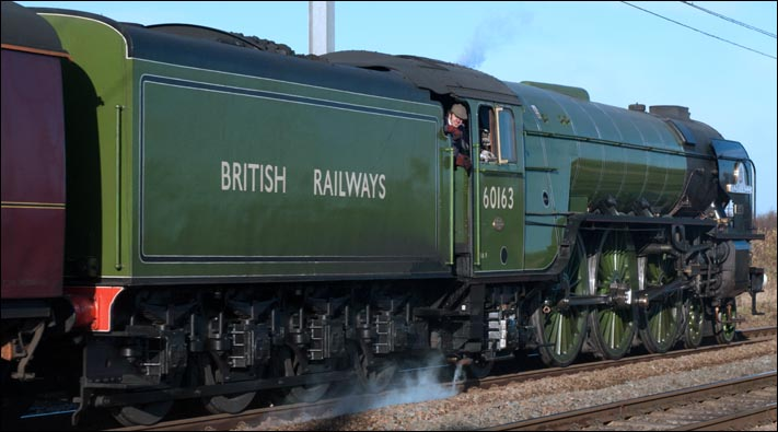 Tornado with full British Railways on its tender is in its early green colours at Conington on the same day