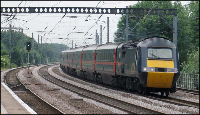 GNER HST with a down train on the down fast though Huntingdon station 2006