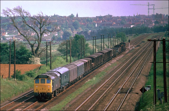 Class 25 on a mixed freight north of Kettering station in BR days.