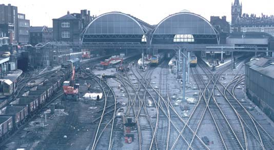 Over view of Kings Cross station in BR days while work goes on to alter the track layout at Kings Cross with station still working.