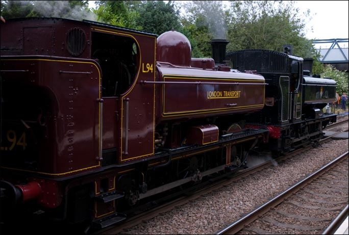 GWR class 57XX pannier tanks one in London transport colours as L49 and GWR 0-6-0ST 9600 in BR lined black at Melton Mowbray Station in 2012