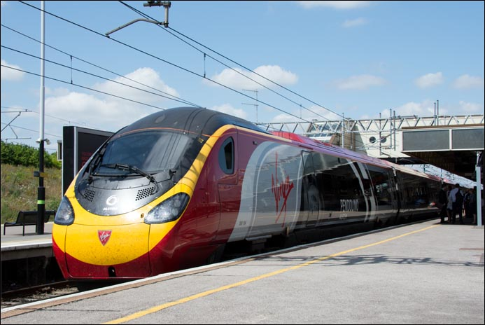 Virgin class 390 104 Pendolino in Milton Keynes Central station on an up train on the 22nd of July  2014
