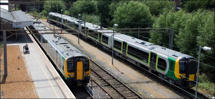 London Midland Class 150 015 in Northamton station and London Midland 150 371