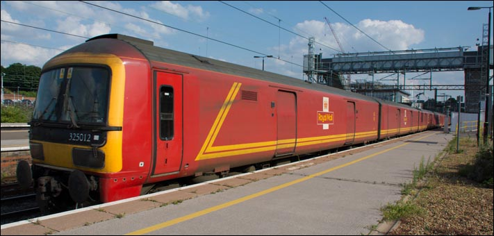 Class 325012 Royal Mail EMU heading north at Northamton station on 24th of July 2014
