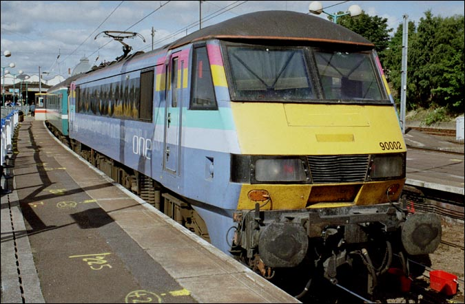 "90002 in the then new ""ONE"" colours with a train to London from Norwich in 2005"