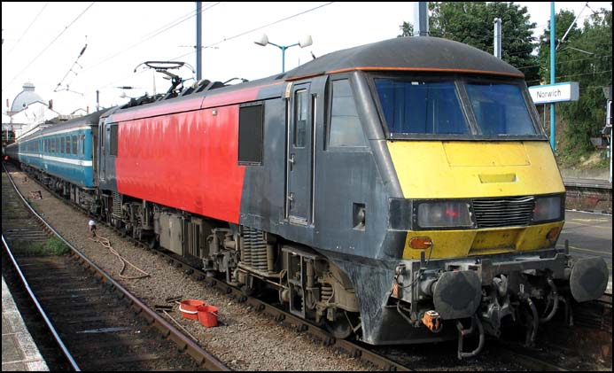One unbranded ex Virgin Trains class 90 in Norwich station in 2005