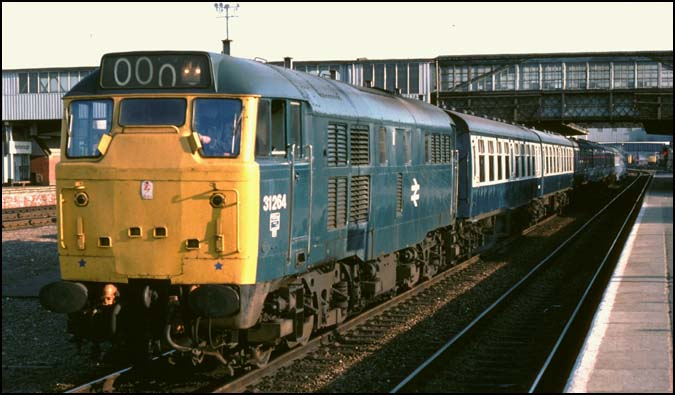 Class 31264 in platform 3 at Peterborough on a stopping train to London Kings Cross station.