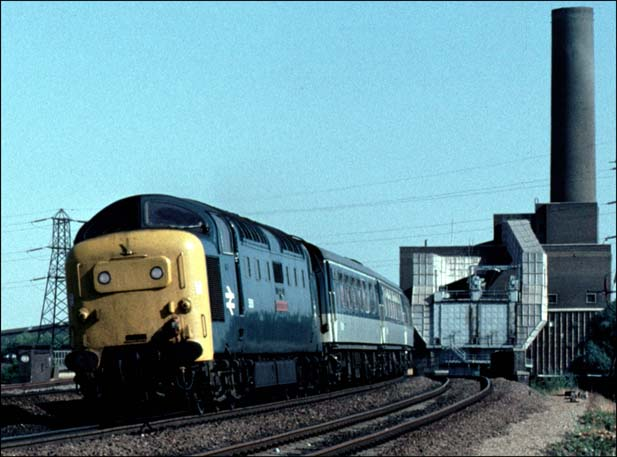 Class 55 Deltic on the up fast line with old Peterborough power station in the back ground
