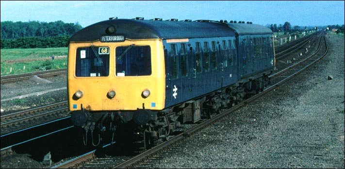 A DMU on the down slow at Walton on a train from Spalding.