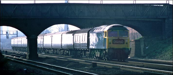 A class 47 on a down train which has just come under the Fletton High Street road bridge