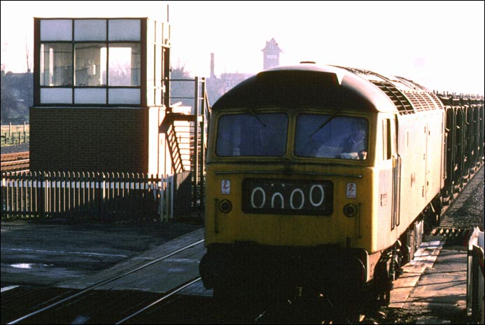 class 47 on a fly-ash Train on the Stamford line at the site of Walton Crossing