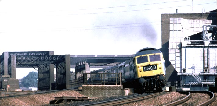 A class 47 is just crossing the Peterborough to March railway line. The rest of the train is on the river Nene bridges