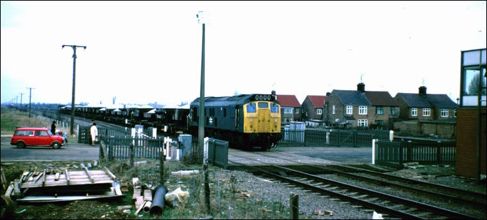 A class 25 at Walton level crossing when it was open.