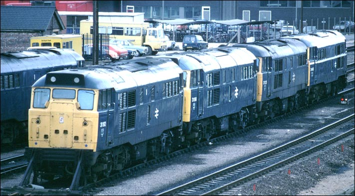 Four class 31s at Peterborough Depot 31192  31198  31125 3 1403  plus one on the next line.