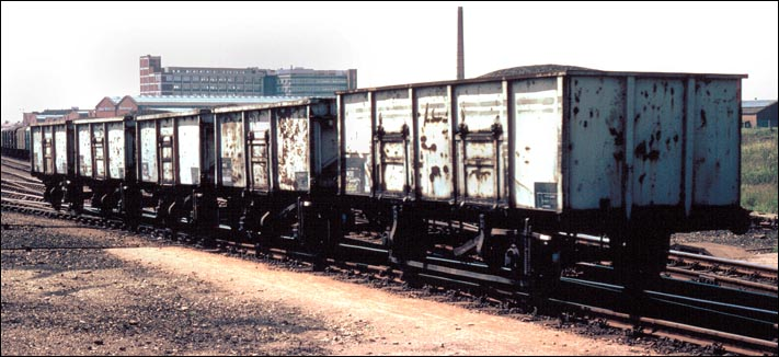 Five steel mineral wagons in Westwood Yard