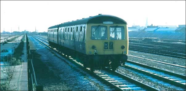 DMU in BR days going past the old platforms of the East station at Peterborough