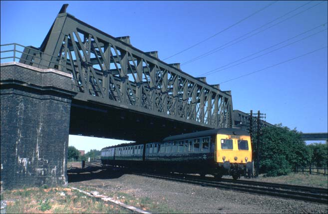 DMU in BR days coming under the ECML on the Peterborough March line