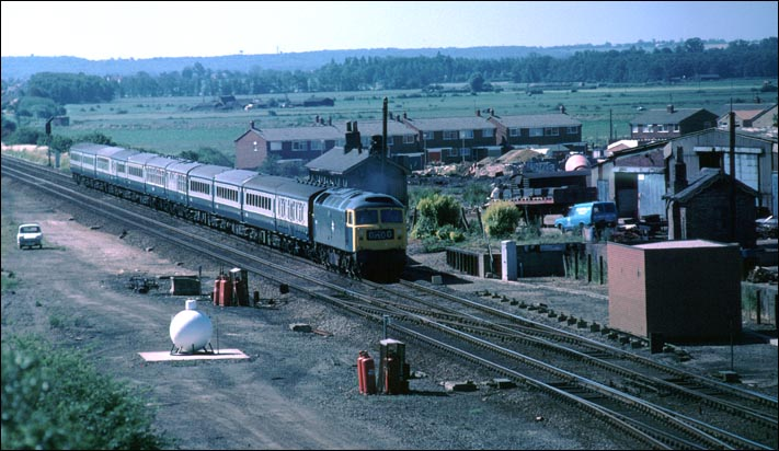 A class 47 on a down train at the site of Yaxley station