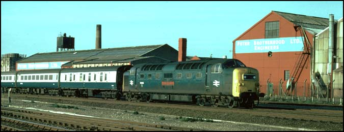 A class 55 Deltic on the up fast on the ECML at Walton next to Peter Brotherhood Factory