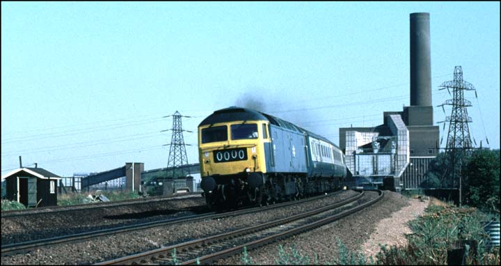 Class 47 on a up train with the now closed and removed Peterborough power station behind