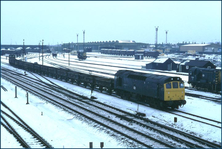 A Class 25 comes out of Westwood Yard with a freight on a cold winters day