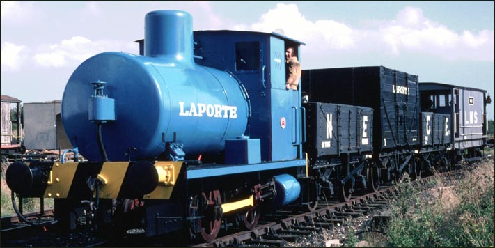 blue 0-4-0 Laporte Fireless steam locomotive number 2243 is on a demonstration goods train in early 1980s