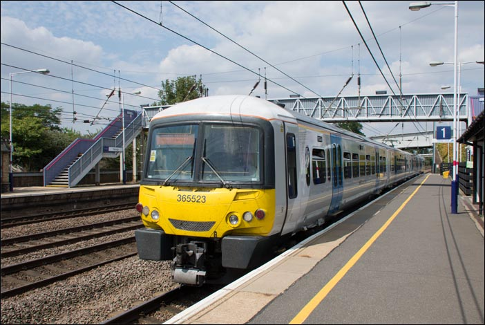 First Capital Connect class 365523 comes into platform 1 at Sandy railway station on Tuesday 29nd of July 2014