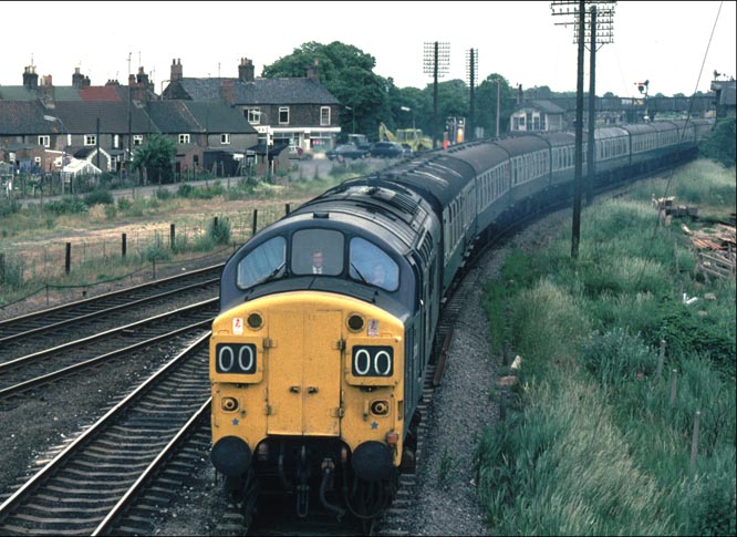 A class 37 comes onto the Spalding to March line