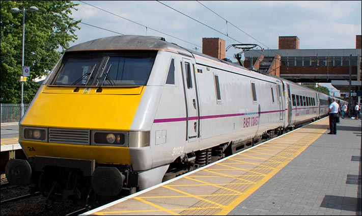 East Coast class 91124 on a Down train in Stevenage station on the 29th of July 2014