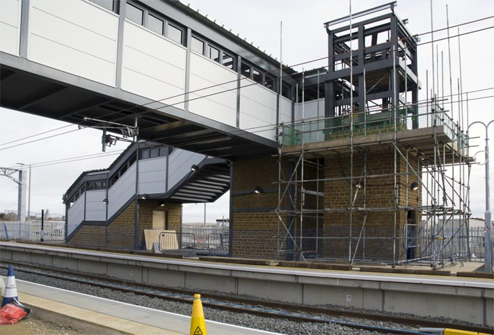 foot bridge at at Wellingborough station which is now open but the lift on the far side was still being built
