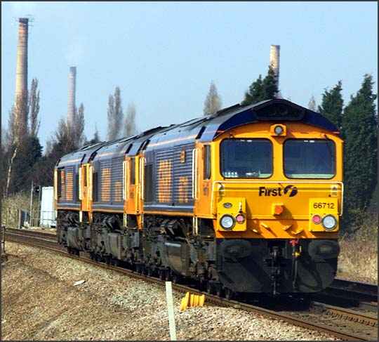Three GBRf class 66s with 66712 at the rear heading for Peterborough