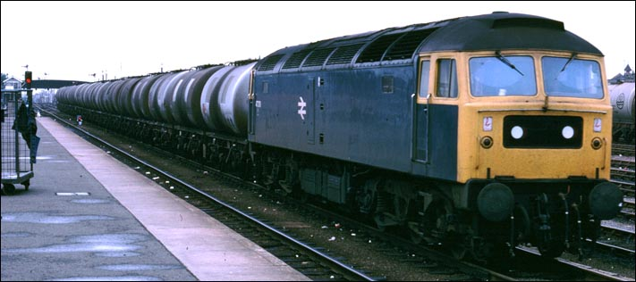 class 47 on a tanker train comes past Cambridge station