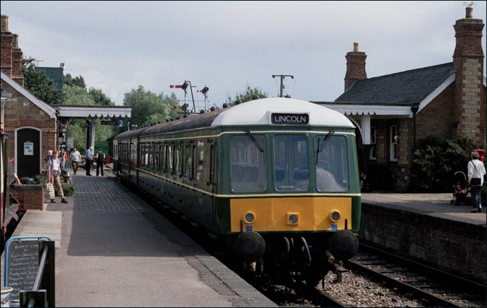 Castle Hedingham station with a DMU in the station