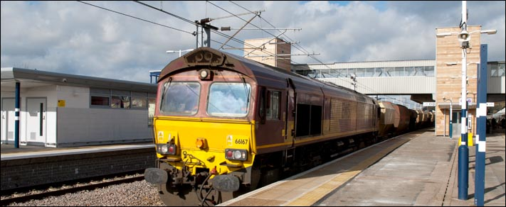 Class 66167 with a freight in platform 5 on the 21st of February 2014
