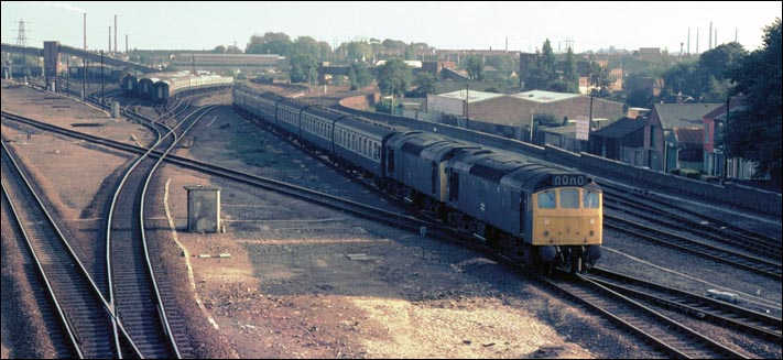 A pair of class 25s come from the bridge over the river Nene past what is now Great Notherns EMU sidings