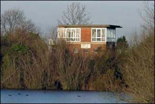 Sleaford South signal box from across a lake in November 2004