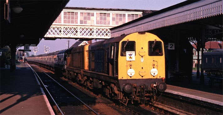 class 20s in Sleaford station with a Skegness (jolly fisherman?) sign on it.