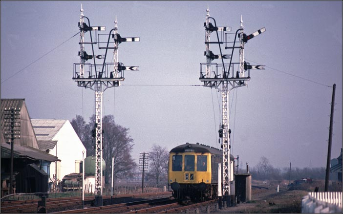 DMU to Shefield comes into Sleaford station past two fine signals